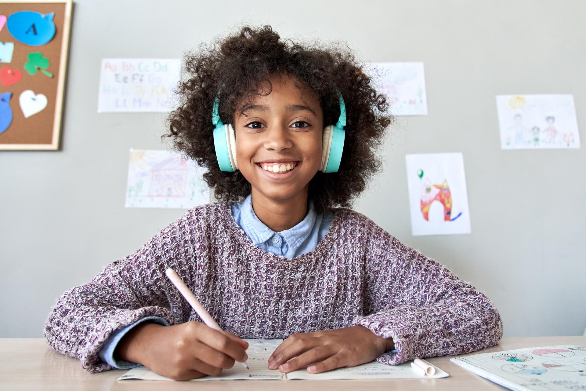 Happy,African,American,Kid,Child,Girl,Wearing,Headphones,Looking,At